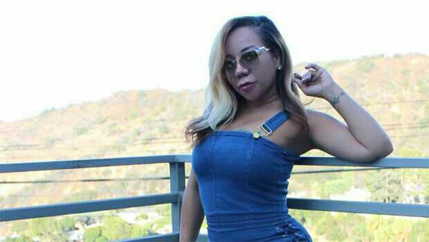 Tiny looking sexy As She Flaunts Curves In Tight Denim One Piece